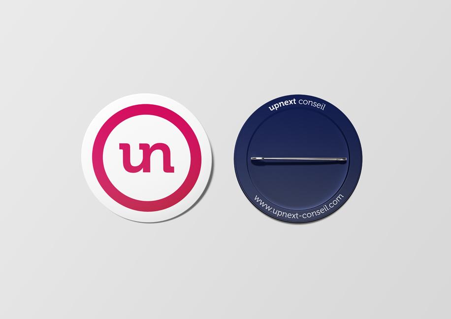 Upnext Conseil Branding - Création badge